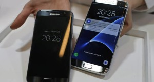 Samsung Galaxy S7, left, and S7 Edge are displayed during the Samsung Galaxy Unpacked 2016 event on the eve of this weeks Mobile World Congress wireless show, in Barcelona, Spain, Sunday, Feb. 21, 2016. (AP Photo/Manu Fernadez)
